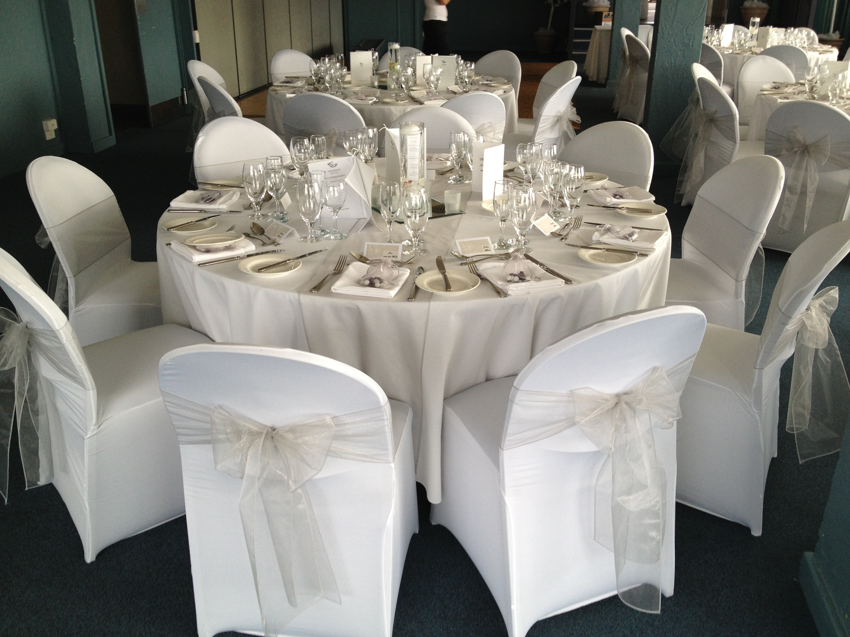 White chair covers with white sash - White Lycra Chair Covers With Silver Organza Sashes And Silver Organza Table Runners By Special Day Wedding Hire